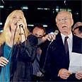 Yitzhak Rabin (R) sings at the peace rally where he was later killed Photo: Michael Kramer