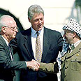 Rabin (L), Clinton and Arafat at signing Photo: Reuters