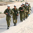 Will refuseniks be punished? IDF patrol Photo: Tsafrir Abayov