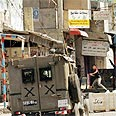 Back in town: IDF jeep in Tulkarem Photo: Reuters