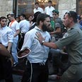 Ultra-religous men scuffle with police during last Thursday's gay pride march Photo: Haim Tzach