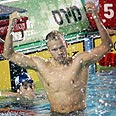 Israel&#39;s Yoav Gat celebrates 200-meter backstroke win Photo: Meir Partush