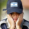 Female soldier in tears Photo: AP