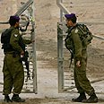 Soldiers locking up Kissufim settlement gate last summer Photo: AP