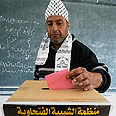 Fatah member casting his vote Photo: AFP