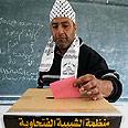 Fatah member casting his vote Photo: AFP