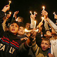 Gazans rally in the dark Photo: AFP