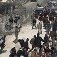 Palestinians storm border Photo: AP