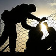 Border guards seal fence Photo: AFP