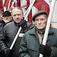 Latvians at Nazi parade Photo: AFP
