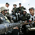 Palestinian forces in Hebron Photo: Reuters