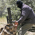 Palestinian fires mortar (Archive photo) Photo: AP