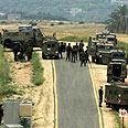 Soldiers near scene of deadly clash Photo: Tsafrir Abayov