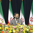 Ahmadinejad on backdrop of Iranian flag Photo: AFP