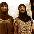 B. Two women in traditional Yemeni clothing