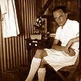 A. Dr. Ullman in the laboratory hut, Fayush 1943