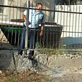 Policeman near rocket&#39;s landing spot Photo: Ze&#39;ev Trachtman