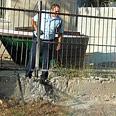 Policeman near rocket's landing spot Photo: Ze'ev Trachtman