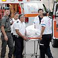 MDA team prepares to transport body Photo: Amir Cohen
