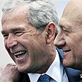 Bush with former PM Olmert during visit to Israel Photo: AP