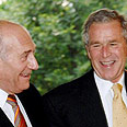 Prime Minister Ehud Olmert and US Presdient George W. Bush - all smiles Photo: AFP