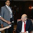 Olmert speaking to press Photo: AFP