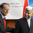EU's Solana with Iranian negotiator Jalili at Geneva Photo: AFP