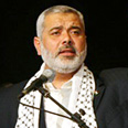 Haniyeh. With a gun and Koran Photo: AFP