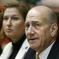'Voiced his objection.' Olmert with FM Livni Photo: Reuters