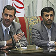 Presidents Assad (L) and Ahmadinejad Photo: AP
