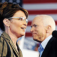 Making headlines. Palin and McCain Photo: AFP
