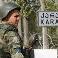 Russian soldier at roadblock Photo: AP
