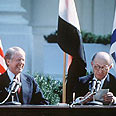 Sadat with Jimmy Carter, signing the peace treaty