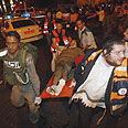 Paramedics evacuating wounded Photo: Reuters