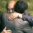 Brockmann embraces Ahmadinejad Photo: Reuters