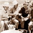 A. Members of Kibbutz Kfar Masaryk prepare for ceremony