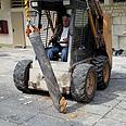 Tractor pulls Grad from ground Photo: Jonathan Legayev