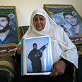 Hassan Salameh's mother with her son's photo Photo: AFP