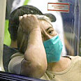 Citizens don masks Photo: AFP
