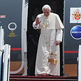 Pope takes first step out of plane Photo: Yaron Brener