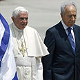Greeted by President Peres Photo: Reuters