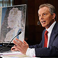 Blair. Outlining a solution Photo: AP