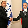 Lieberman with Putin in Russia Photo: AP