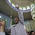 Ahmadinejad celebrates disputed victory Photo: Reuters