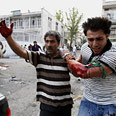 Mousavi supporter injured during protest Photo: AFP