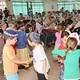 Kindergarten kids perform to survivors Photo: Avraham Venismach