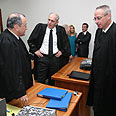 Olmert's lawyers with state prosecutor Photo: Gil Yohanan