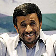 Ahmadinejad, smiling, not laughing Photo: AFP
