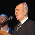 Peres speaking at rally Photo: Ofer Amram