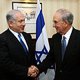 Netanyahu and Mitchell in London Wednesday Photo: Amos Ben Gershom, GPO